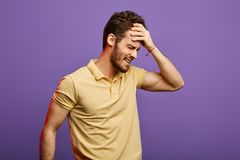 Frustrated man having problems with head after night party.hangover concept royalty free stock photos