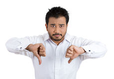 Unhappy angry man giving two thumbs down gesture Stock Images