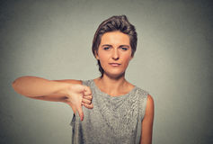 Unhappy, angry, pissed off woman, annoyed giving thumbs down gesture. Closeup portrait of unhappy, angry, mad, pissed off woman, annoyed giving thumbs down Royalty Free Stock Photography