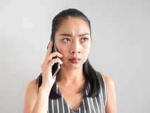 Unhappy and angry woman talking on smartphone. Stock Image