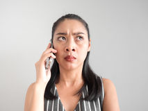 Unhappy and angry woman talking on smartphone. Stock Photography