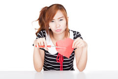 Unhappy Asian girl cut heart shape paper Royalty Free Stock Images
