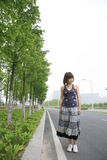 Unhappy asian girl outside Stock Image