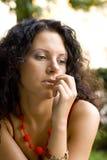 Unhappy attractive brunet woman. Outdoor portrait of unhappy attractive brunet woman Royalty Free Stock Image