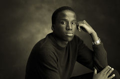 Unhappy b/w. Portrait of a young black man thinking Stock Images