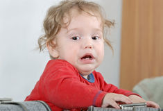 Unhappy baby in red shirt Stock Photography
