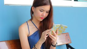 Unhappy Bored thai adult beautiful read message on Smartphone. Unhappy Bored thai adult beautiful girl read message on Smartphone stock footage