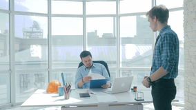 Unhappy boss giving reprimand to office worker. stock video