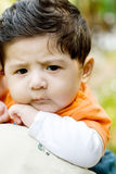 Unhappy boy. A unhappy 4 months old baby boy on his mother's shoulder Stock Photo