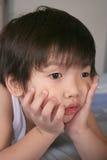 Unhappy Boy. Holding chin Stock Photos