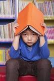 Unhappy Boy with Book Stock Photo