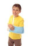 Unhappy boy broken arm stock images