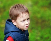 Unhappy boy. Little four years boy outdoor looking unhappy Royalty Free Stock Image