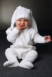 Unhappy boy with panty on head Royalty Free Stock Images