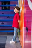 Unhappy Boy Standing Against Wall Royalty Free Stock Photo