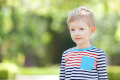 Unhappy boy. Upset and unhappy little boy outdoors Royalty Free Stock Photos