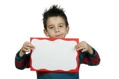 Unhappy Boy who holds white board. Stock Photos