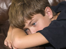 Unhappy boy2. An unhappy boy with a tear in his eye Royalty Free Stock Images