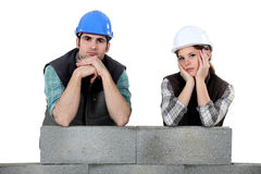 Unhappy bricklayers. A unhappy team of bricklayers Royalty Free Stock Image