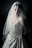 Unhappy Bride against Dark Background Royalty Free Stock Images