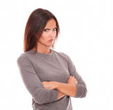 Unhappy brunette in grey blouse looking angry. And serious in white background Stock Photography