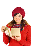 Unhappy brunette opening christmas gift Royalty Free Stock Images