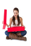 Unhappy brunette opening present Stock Photography