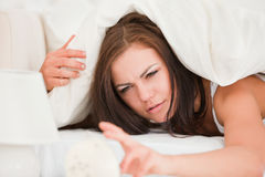 Unhappy brunette waking up Stock Images