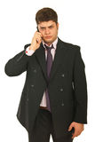 Unhappy business man by cell Stock Photos