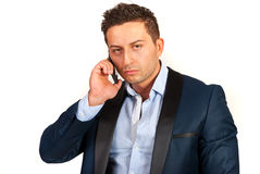 Unhappy business man on phone mobile Royalty Free Stock Photos