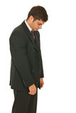 Unhappy business man walking Royalty Free Stock Photography