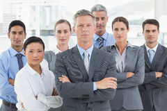 Unhappy business people looking at camera with arms crossed Royalty Free Stock Photos