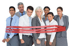 Unhappy business people surrounding by red strip stock photo