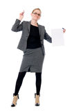 Unhappy business woman with a blank sheet of paper. Girl in full growth Royalty Free Stock Photo