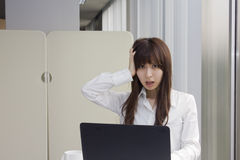 Unhappy business woman in front of Laptop computer in office Royalty Free Stock Photos