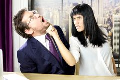 Unhappy business woman hitting boss in face Royalty Free Stock Photography