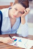 Unhappy business woman looking displeased working on financial report. Closeup portrait unhappy business woman looking displeased working on financial report Royalty Free Stock Photography
