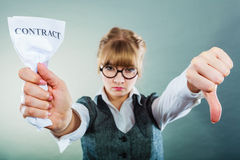 Unhappy business woman showing crumpled contract Stock Image