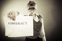Unhappy business woman showing crumpled contract Stock Images