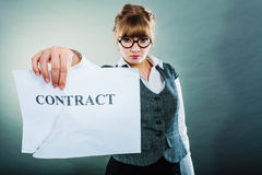 Unhappy business woman showing crumpled contract Royalty Free Stock Photos
