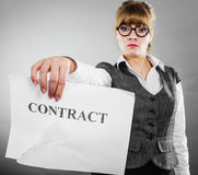 Unhappy business woman showing crumpled contract Stock Photos