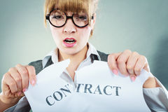Unhappy business woman showing crumpled contract Royalty Free Stock Images