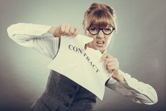 Unhappy business woman showing crumpled contract Royalty Free Stock Photography
