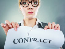 Unhappy business woman showing crumpled contract Stock Photo