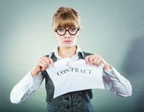 Unhappy business woman showing crumpled contract Royalty Free Stock Image