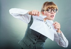 Unhappy business woman showing crumpled contract Royalty Free Stock Photo