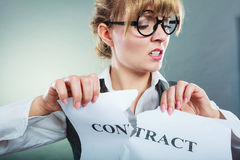 Unhappy business woman showing crumpled contract Stock Photography
