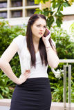 Unhappy Business Woman Talking On Cell Phone Royalty Free Stock Images