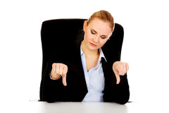 Unhappy business woman with thumbs down Royalty Free Stock Photography