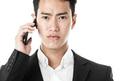 Unhappy businessman answering a call Royalty Free Stock Photo